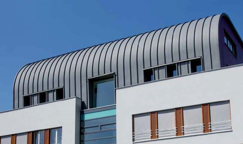 Residential and commercial building Marburg (material: titanium-zinc pre-weathered curved)